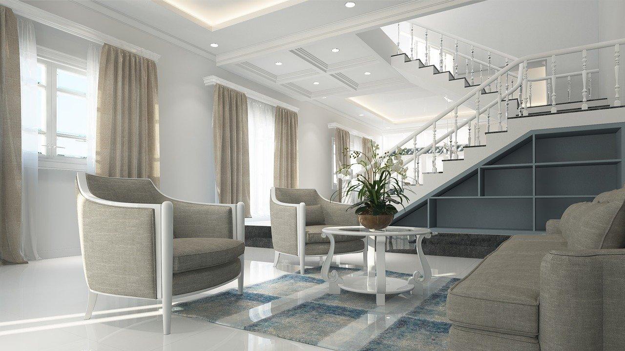סלון בצבע אפור ומדרגות ברקע